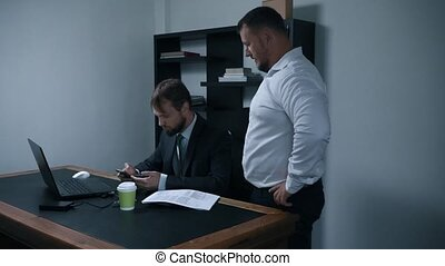 two businessmen argue about signing a contract of documents in the office, the chief and subordinate, slow motion