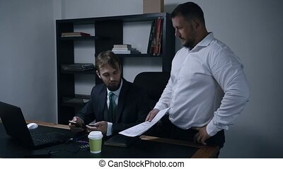 two businessmen argue about signing a contract of documents in the office, the chief and subordinate, man throws documents, slow motion