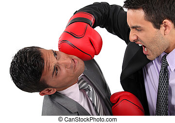 Two businessmen boxing