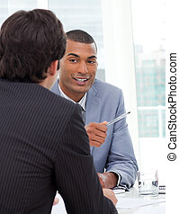 Two businessmen discussing in a meeting