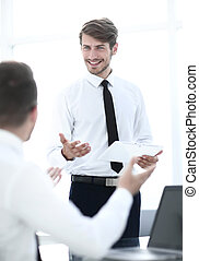 two businessmen discussing something in the office
