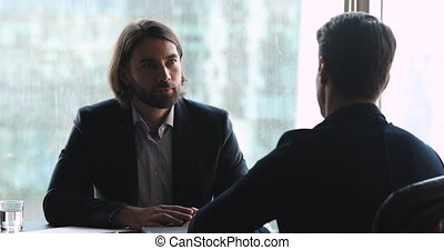 Two businessmen employer and job seeker talking at job interview
