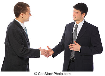 Two businessmen greet