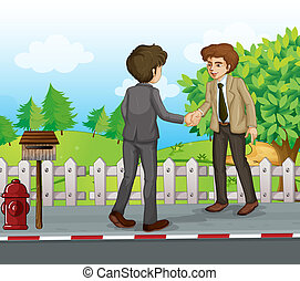 Two businessmen handshaking at the street
