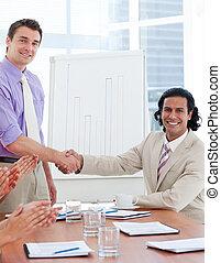 Two businessmen having a handshake