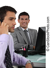 two businessmen in the office