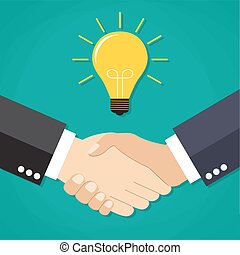Two businessmen shake hands for a deal