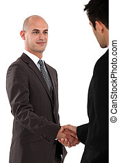 Two businessmen shaking hands