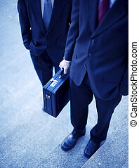 businessmen - two businessmen standing on steps with hands ...