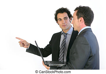 Two businessmen stood with laptop