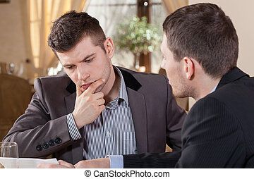 Two businessmen talking about an offer - Two businessmen ...