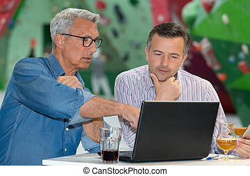 two businessmen working in a bar