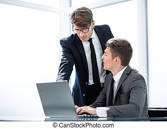 two businessmen working in the office.