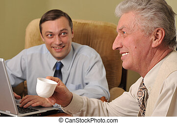 Two businessmen working in the office with computer