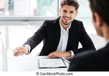 Two businessmen working on business meeting in office