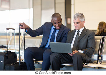 businessmen working on laptop computer