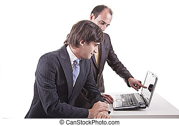Two businessmen working together on a laptop
