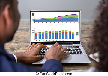 Two Businesspeople Analyzing Financial Graph