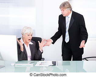 Two Businesspeople Arguing With Each Other