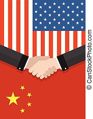 Two businesspeople handshake after good deal in front of an american and chinese flag. two flags face to face, symbol for the relationship between the two countries.