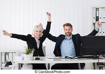 Two Businesspeople Raising Hands
