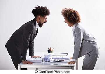 Two Businesspeople Shouting At Each Other