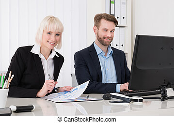 Two Businesspeople Using Computer