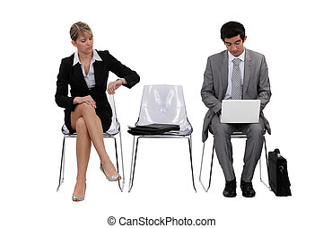 Two businesspeople waiting