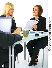 Two Businesswoman Discussing Paperwork