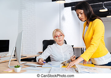 Two businesswoman having a meeting in the office