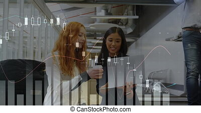 Two businesswoman looking at a laptop in an office 4k