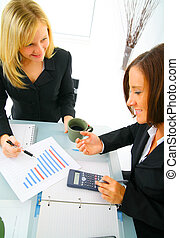 Two Businesswoman Working On Numbers