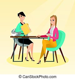 Two businesswomen during business meeting.