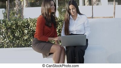 Two businesswomen having an informal meeting