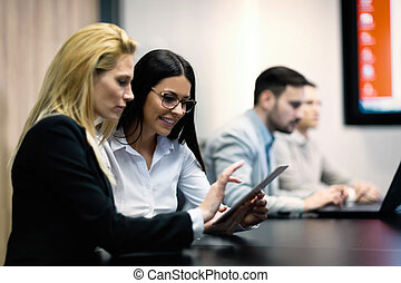 Two businesswomen having discussion in conference room