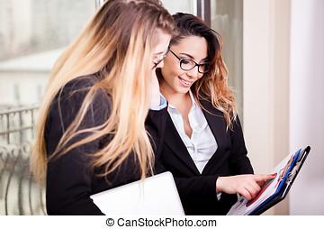 Two businesswomen near the window