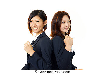 Two businesswomen smiling
