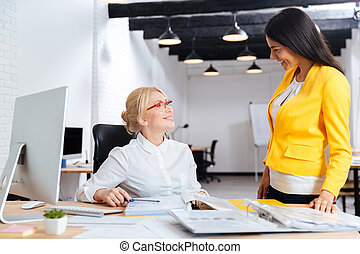Two businesswomen working together in the office