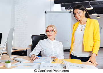 Two businesswomen working together on the computer at the table