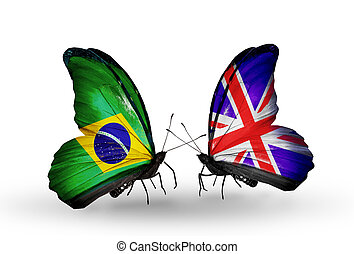 Two butterflies with flags on wings as symbol of relations Brazil and UK