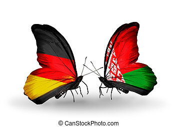 Two butterflies with flags on wings as symbol of relations Germany and Belarus