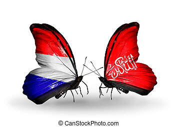 Two butterflies with flags on wings as symbol of relations ...