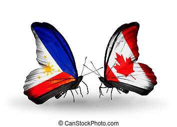 Philippines and canada waving philippine and canadian flags two butterflies with flags on wings as symbol of relations philippines and canada gumiabroncs Choice Image