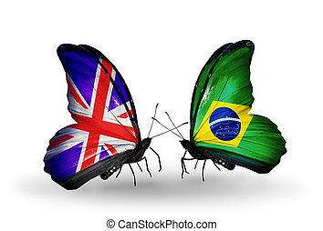 Two butterflies with flags on wings as symbol of relations UK and Brazil