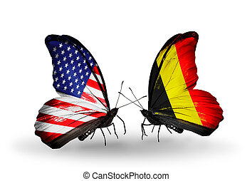 Two butterflies with flags on wings as symbol of relations USA and Belgium