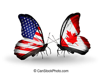 Two butterflies with flags on wings as symbol of relations USA and Canada