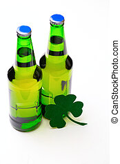 Two buttle of green beer on white background