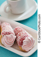 Two cakes with pink cream on a blue background