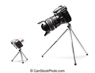 Two cameras big and small. Isolated on white.