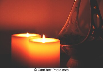 two candles and a vase